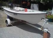 Barco a motor com atrelado en salvaterra de magos