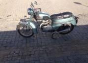 Moto antiga triumph twenty one 1960 gasolina cor azul
