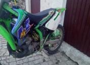 Kawasaki de 99 gasolina cor verde