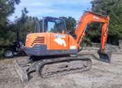 Retro escavadora New Holland