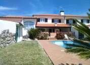 Moradia t4 com excelentes areas jardim e piscina.